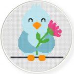 Spring Bird Holding Flower Cross Stitch Illustration